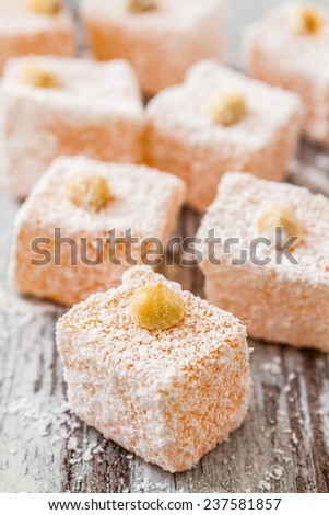 Assortment of Turkish Delight on wooden white background