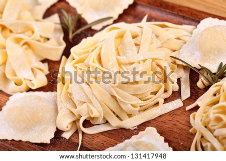 Assortment of uncooked pasta - stock photo