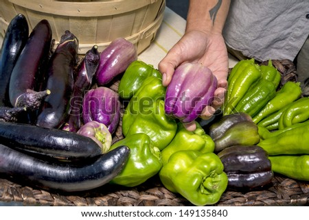 Assortment of vegetables with a purple bell pepper - stock photo
