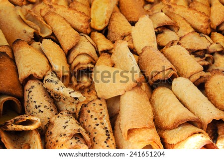 Assortment of waffles cookies (natural, with almonds and with chocolate chips) at the market. - stock photo