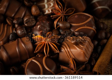 Assortment of white, dark, and milk chocolate. Chocolate with cream, nuts, almonds, hazelnuts and cinnamon with coffee beans. Sweet food and no diet concept. - stock photo