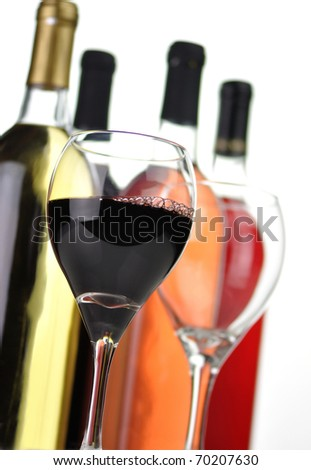 assortment of wine bottles and glasses - stock photo