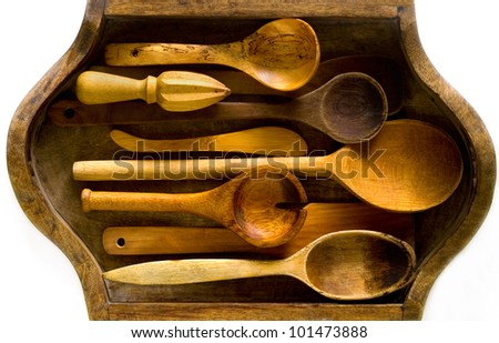 Assortment of wooden kitchen utensils in vintage in a tray - stock photo