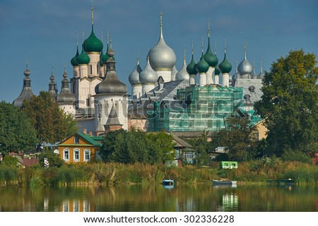 Assumption Cathedral and church of the Resurrection in Rostov Kremlin. The ancient town of Rostov The Great is a tourist center of the Golden Ring of Russia. - stock photo