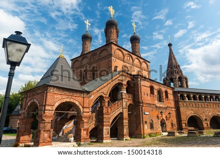 Assumption Cathedral on the historic street in central Moscow, Russia. Krutitskoe Compound is an architectural monument of XVII-XIX centuries. - stock photo