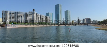 Astana Kazakhstan. Two modern skyscrapers at river bank. - stock photo