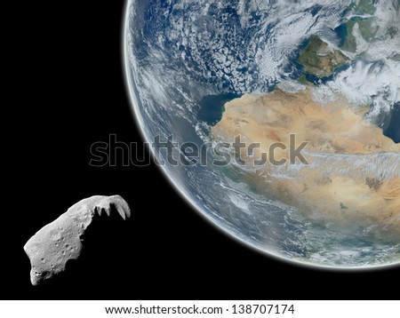 Asteroid approaching Earth. Elements of this image furnished by NASA.