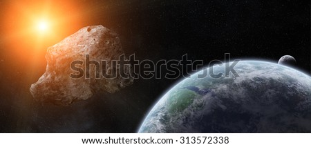 Asteroids flying close to the planet Earth - stock photo