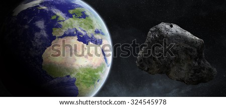 Asteroids flying close to the planet Earth 'elements of this image furnished by NASA' - stock photo
