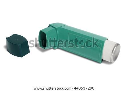 Asthma inhaler isolated on white background - stock photo