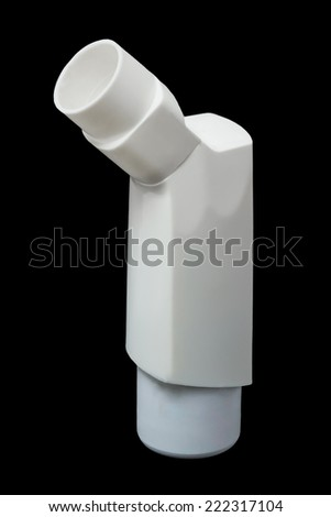 Asthma inhaler spray on a black background - stock photo