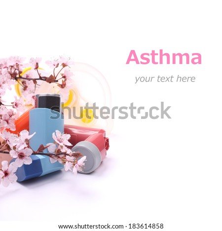 Asthma inhalers with extension tube for children and blossoming tree branches over white with easy removable sample text - stock photo