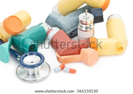 Asthma inhalers with medication and stethoscope. - stock photo