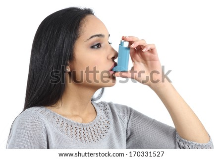 Asthmatic arab woman breathing from a inhaler isolated on a white background