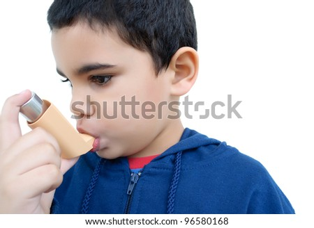 asthmatic kid using an aerosol spray isolared on white - stock photo
