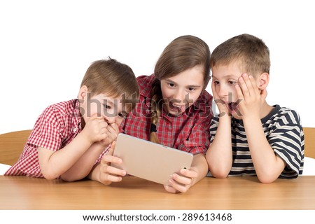 Astonished Brothers and Sister With Digital Tablet, Half-Length Studio Shot Isolated on White - stock photo