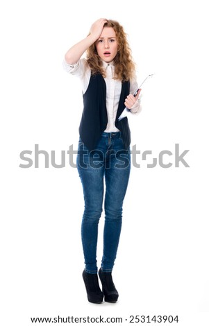 Astonished business woman with a writing tablet in full growth. Isolated on a white background - stock photo