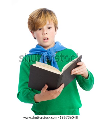 Astonished child reading a book