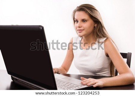 Astonished office girl behind a laptop