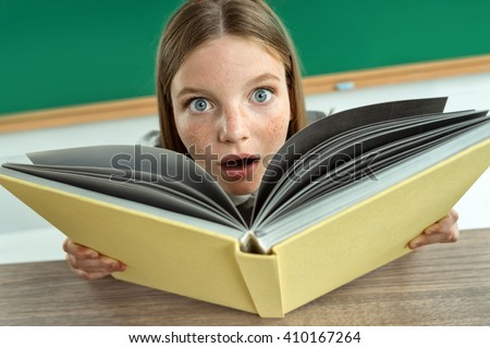 Astonished pupil staring at you with her mouth open. Photo of teen school girl, creative concept with Back to school theme - stock photo