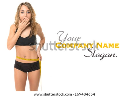 astonished slim woman measuring her waist - stock photo