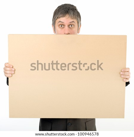 Astonished Staring Adult Man Behind Banner Isolated on White Background - stock photo