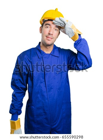 Astonished workman with search gesture on white background
