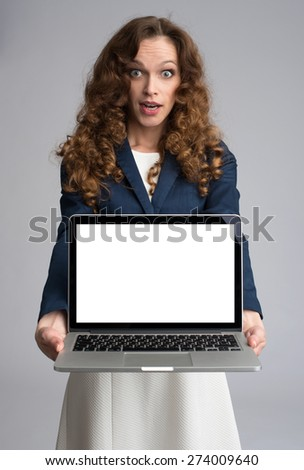 astonishment woman showing something on laptop screen - stock photo