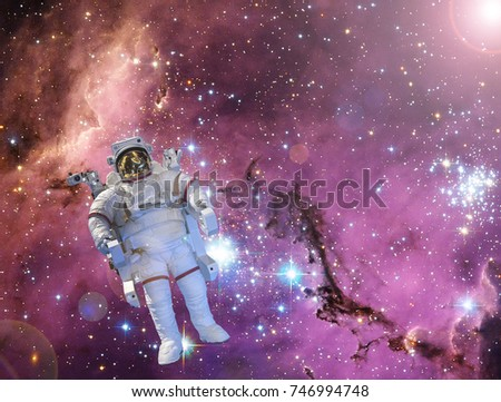 Astronaut against deep space. The elements of this image furnished by NASA.