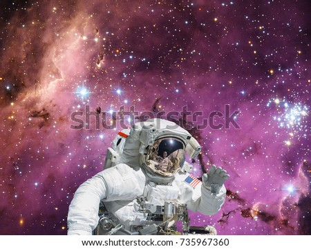 Astronaut and stars on the backdrop. The elements of this image furnished by NASA.