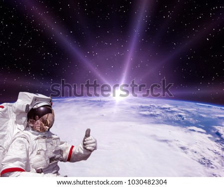 Astronaut and sunrise. The elements of this image furnished by NASA.