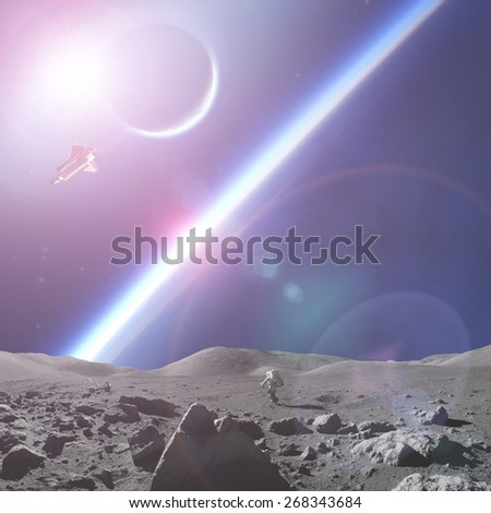 Astronaut as seen from the Moon-like surface planet in a distant galaxy. Elements of this image furnished by NASA. - stock photo