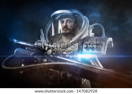 Astronaut, fantasy warrior with huge space weapon - stock photo