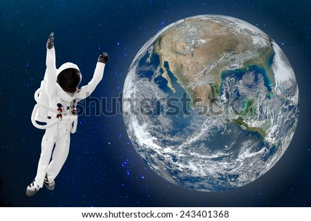 Astronaut floating in space and Earth background. Elements of this image furnished by NASA - stock photo