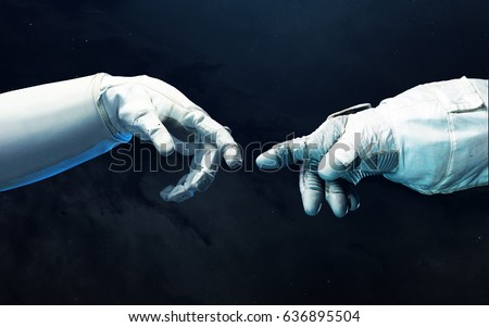 Astronaut hands with background of deep space. Elements of this image furnished by NASA