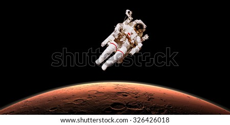 Astronaut in outer space over planet Mars. Elements of the image are furnished by NASA - stock photo