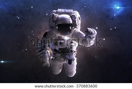 Astronaut in outer space. This image elements furnished by NASA - stock photo