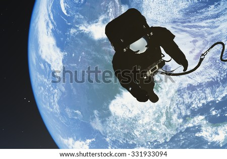 "Astronaut in space above the clouds of the Earth..""Elemen ts of this image furnished by NASA"""