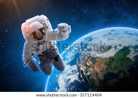 Astronaut Over Earth - Elements of this Image Furnished by NASA