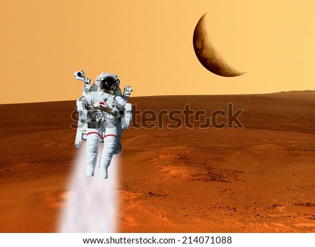 Astronaut planet Mars landscape surface. Elements of this image furnished by NASA. - stock photo