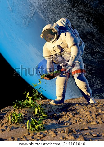 Astronaut planting grass on the planet. - stock photo