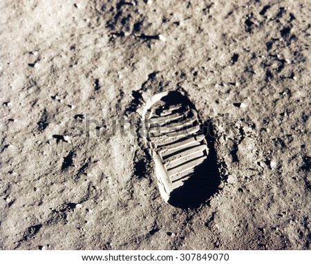 Astronaut's boot print on lunar (moon) landing mission. Elements of this image furnished by NASA. - stock photo