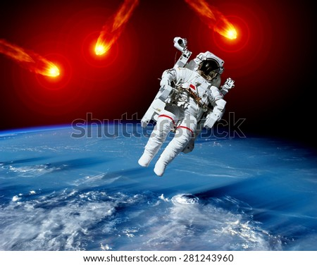 Astronaut spaceman Earth meteor asteroid meteorite space. Elements of this image furnished by NASA. - stock photo