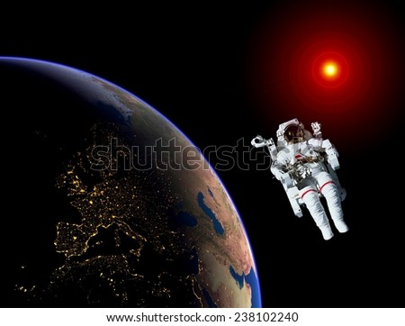 Astronaut spaceman Earth space sun. Elements of this image furnished by NASA. - stock photo