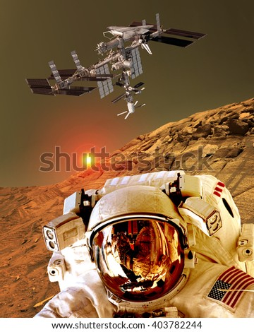 Astronaut spaceman helmet planet Mars surface martian colony space landscape. Elements of this image furnished by NASA. - stock photo