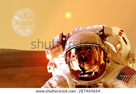 Astronaut spaceman helmet space planet Mars apocalypse Earth. Elements of this image furnished by NASA. - stock photo