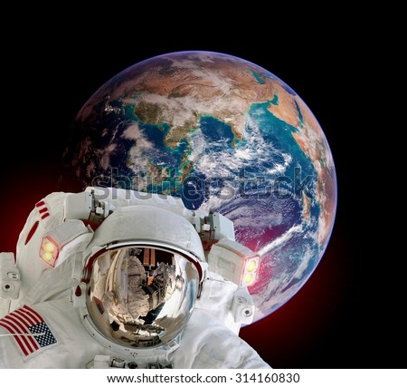 Astronaut spaceman isolated helmet outer space planet earth globe. Elements of this image furnished by NASA. - stock photo