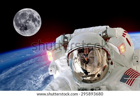 Astronaut spaceman isolated helmet space selfie earth moon. Elements of this image furnished by NASA. - stock photo