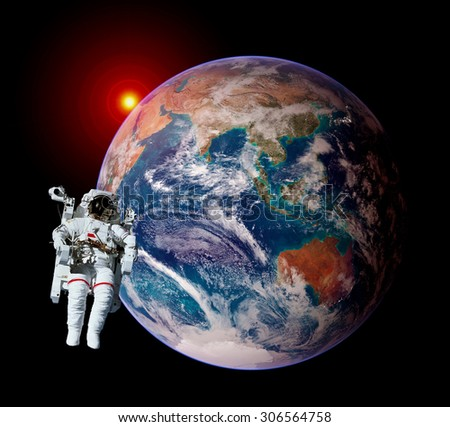 Astronaut spaceman isolated outer space planet earth globe sunrise. Elements of this image furnished by NASA. - stock photo