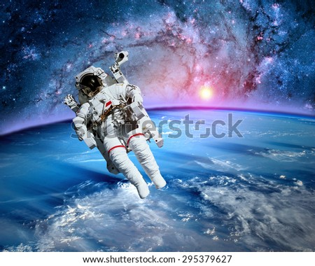 Astronaut spaceman outer space fantasy orbit planet earth sun. Elements of this image furnished by NASA.